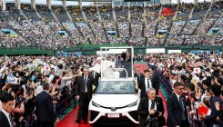 Pope Francis rides in carbon-free popemobile in Japan