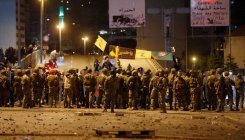 Lebanese protesters clash with supporters of Hezbollah