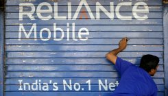 RCom shares up 6% to hit upper circuit on sale buzz