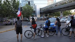 Chileans get on bikes as protests stop public transport