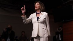 Nancy Pelosi calls Trump 'coward'