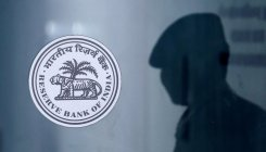 RBI stuns by pausing rate cut