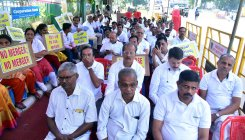 Bank officers oppose merger, stage protest