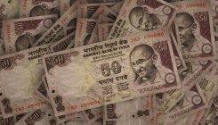 Rupee settles 12 paise up at 70.92 against US dollar