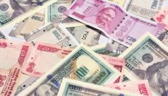 Rupee rises 21 paise to 70.64 against USD