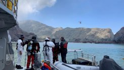 NZ volcano eruption: Divers search for remaining bodies