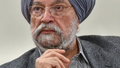 Hardeep Puri hands over registry papers to 20 residents