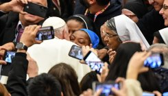'Don't bite!' quips Pope Francis as he kisses nun