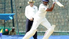 Karnataka escape with a draw