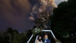 Filipino couple weds under volcanic cloud