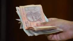 Rupee rises 8 paise to 70.78 against USD in early trade