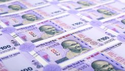 Rupee falls 14 paise, slips below 71 per US dollar