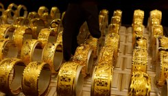 Gold holds ground amid worries over US-China trade deal