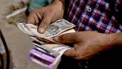 Rupee drops 15 paise to settle at 71.08 against USD