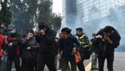 Officers beaten as police disband Hong Kong democracy