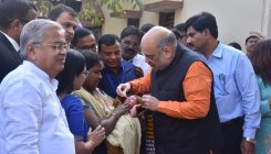 Shah administers polio drops to kids at Joshi's office