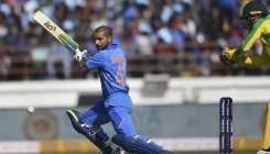 Dhawan hurts left shoulder, walks off field
