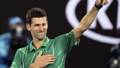 Djokovic survives scare in tough Slam opener