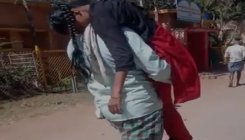 No wheelchair, father carries fainted girl on shoulder