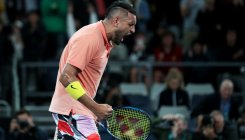 Kyrgios scare as latest freak weather disrupts Aus Open