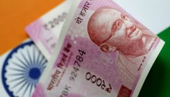 Rupee falls by 7 paise against US dollar