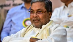 Siddaramaiah to court 'black coat', again