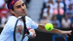 Federer saves match points in Australian Open QF