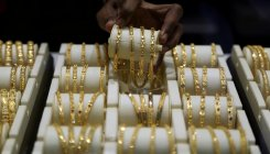 Gold prices rise Rs 111, silver falls Rs 67
