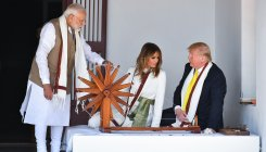 Trump, wife try spinning 'charkha' at Sabarmati Ashram