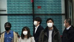 Japan urges teleworking, staggered shifts to curb virus