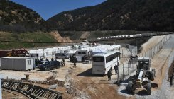 Greece sends nearly 600 migrants to locked camp