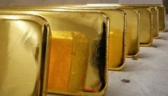 Gold eases but set for best week in 11 years