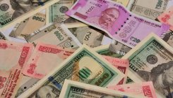 Rupee rises 56 paise to 74.60 against US dollar