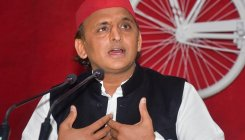 Akhilesh targets UP govt over spraying migrant workers