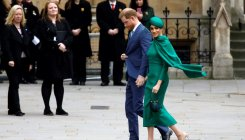 Prince Harry and wife Meghan bid farewell to royal