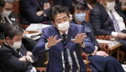 Japan PM Abe offers masks, gets social media roasting