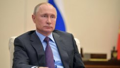 Putin agrees on oil output cuts, blames Saudi for price