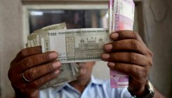 Rupee closes at fresh all-time low of 76.82