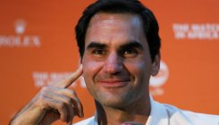 Players back Federer over tennis merger