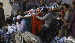 16 dead, 7 missing after Pakistan building collapses