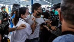 Hong Kong police grapple with pro-democracy protesters