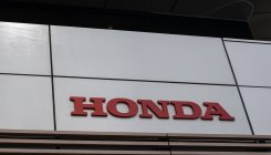 Honda declines to give outlook as profit slides
