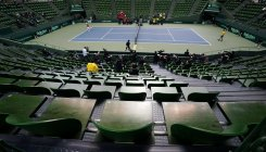 Fist bumps replace handshakes in Davis Cup