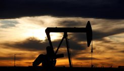 Oil prices gain ground on hopes of re-opening