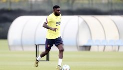 Barcelona's Umtiti suffers calf injury in training