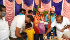 MLA serves biryani at his b'day party with kids