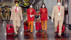 Cabin crew attire to have face shield, gown, mask