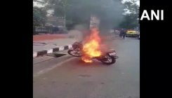 Man fined for riding without helmet sets bike on fire