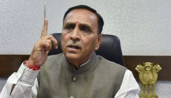 Have to live with coronavirus and also fight it: Guj CM