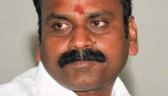 DMK leader loses post after meeting with BJP leader